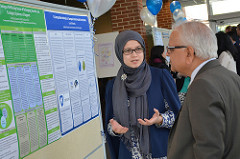 Dr. Kulkarni and a graduate student talking about her research in the poster session