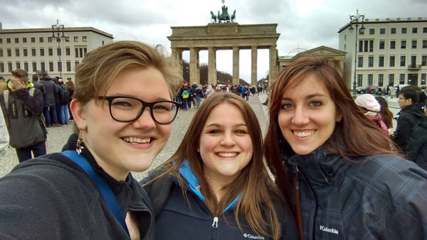 college students posing in front of the Brandenburg Gate in Germany