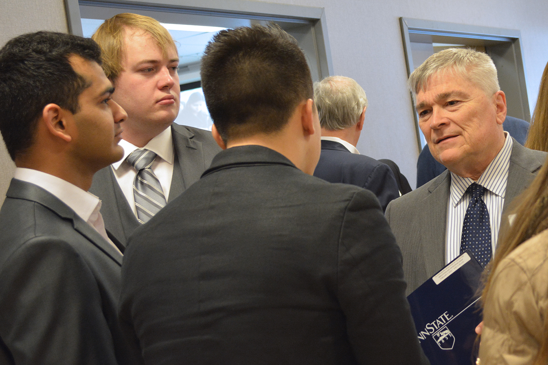 President Eric Barron meets with students