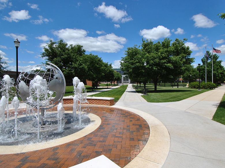 fountain with globe sculpture and campus walkways