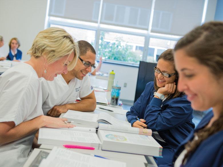 nursing students reading textbook