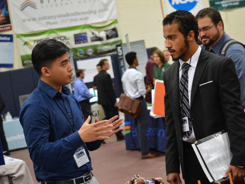Student talking to a recruiter at job fair