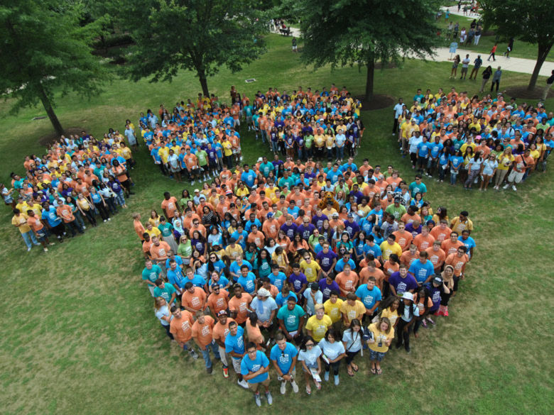 students forming a giant Penn State Paw on the quad