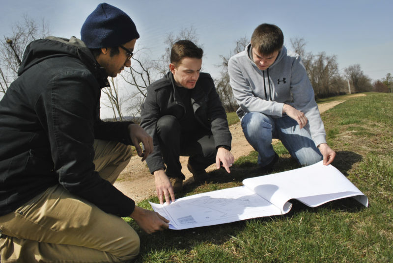 students studying storm water system