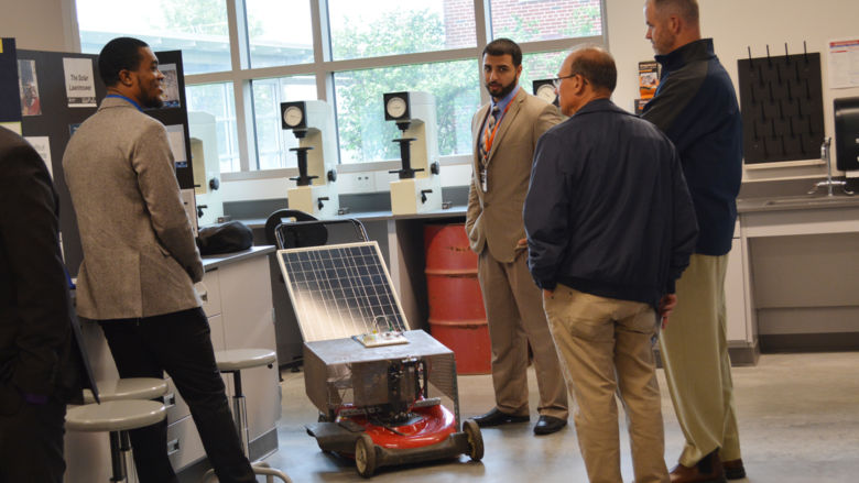Students demonstrate a solar-powered lawn mower