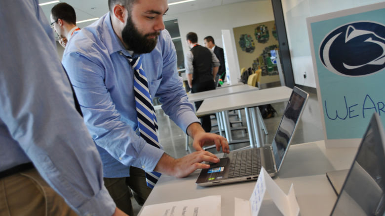 Cody Schory demonstrates software on a laptop