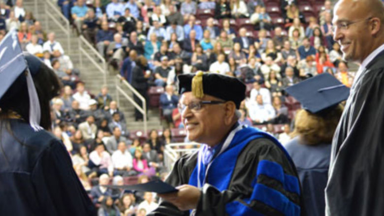 Dr. Mukund Kulkarni and James Franklin congratulate graduates