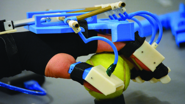 exoskeleton device for hand rehabilitation grips tennis ball