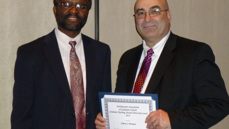 Dr. Simon Bronner (right) and Dr. Peter Idowu, assistant dean for graduate studies (left), at the NAGS award ceremony