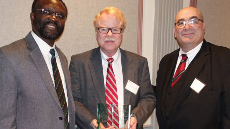 James McClure (center) pictured with Dr. Peter Idowu (left) and Dr. Simon Bronner (right).