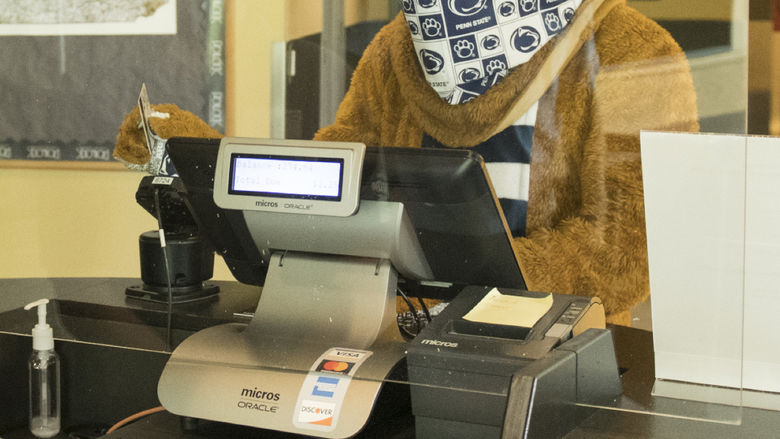 Nittany Lion swiping out hunger at the register in the dining commons