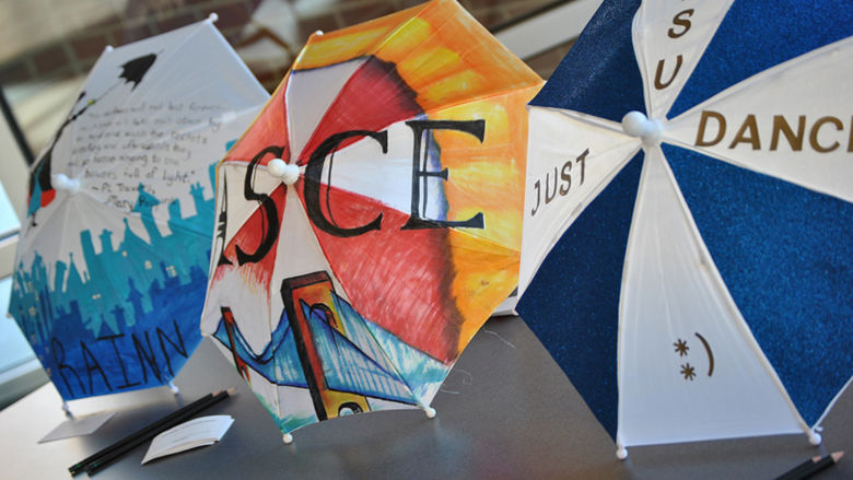 Umbrellas decorated by classes and student clubs/organizations in the RAINN Day theme.