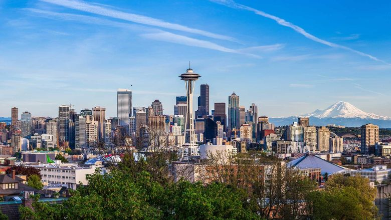A panorama view of Seattle downtown skyline and Mt. Rainier