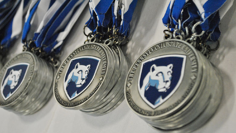 medals with Nittany Lion shield