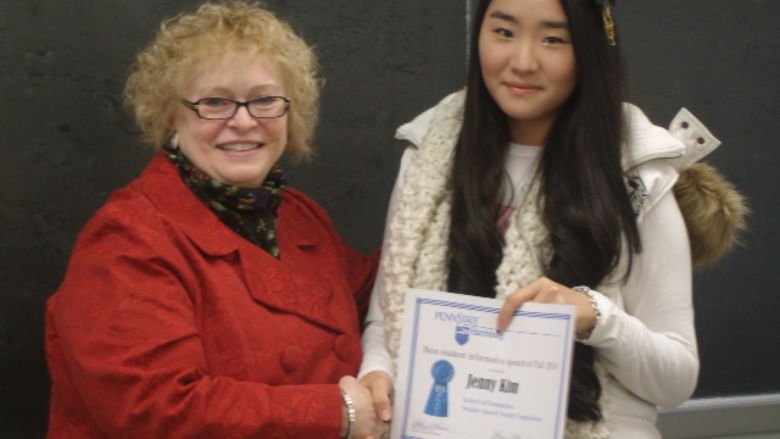 School of Humanities Director Kathryn Robinson presents the Fall 2010 Student Speech Award to Jenny Kim