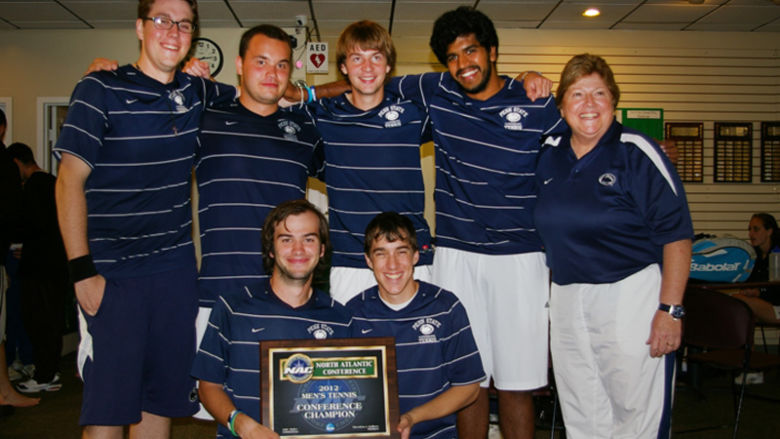Penn State Harrisburg's championship men's tennis team with Head Coach Becky Cecere