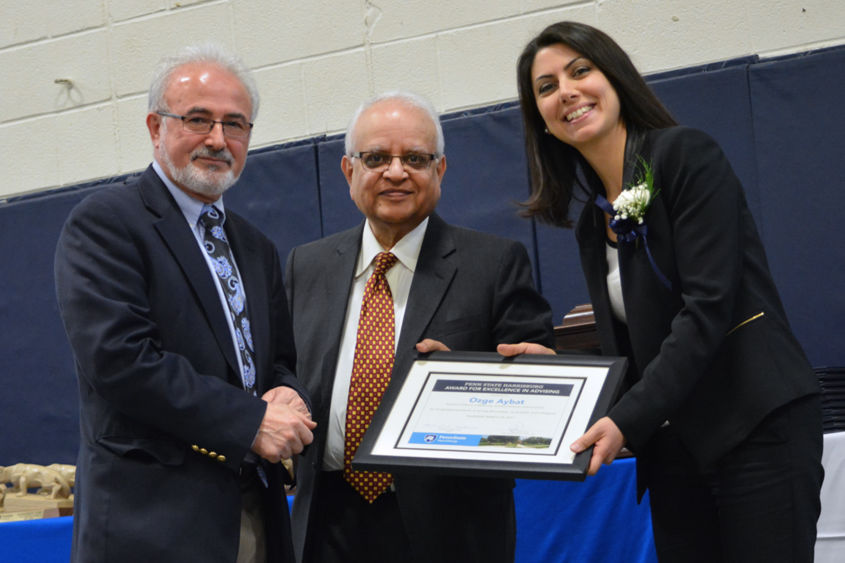Dr. Omid Ansary and Chancellor Mukund Kulkarni congratulate Dr. Ozge Aybat on her Excellence in Advising Award