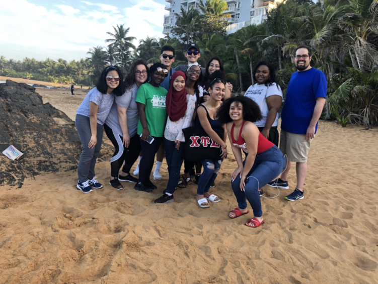 students and chaperones on the beach