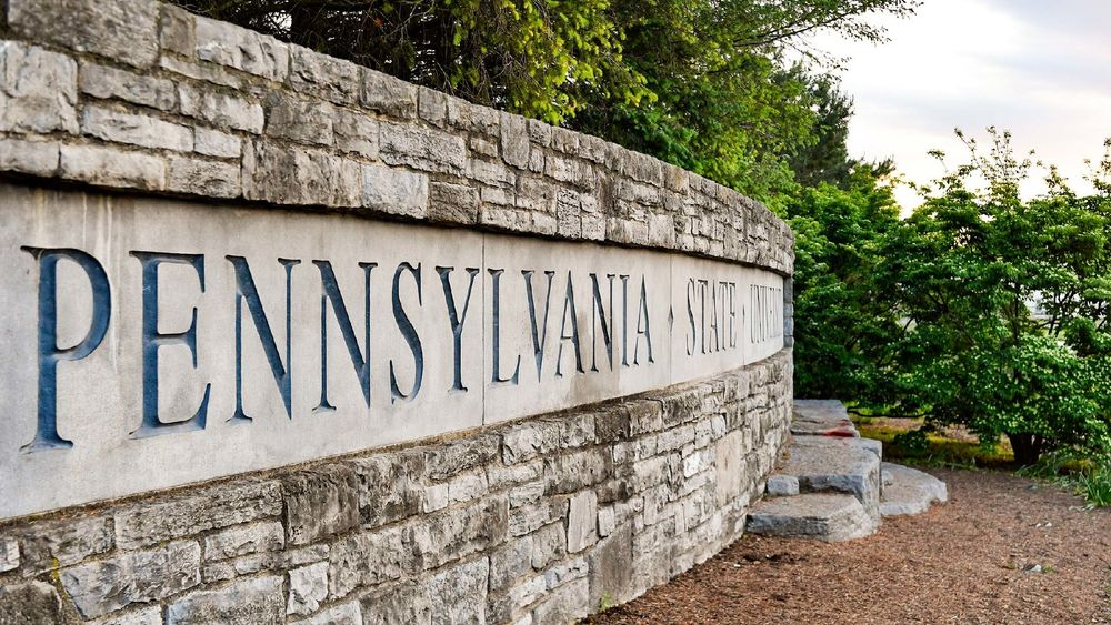 The words 'Pennsylvania State University' are shown on a stone wall.