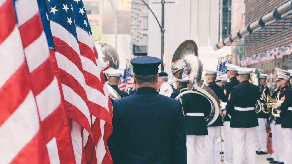 Officers, military band and flag